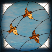 stained glass window birds in flight
