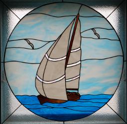 sailing ship stained glass window (linked to calendar of events)